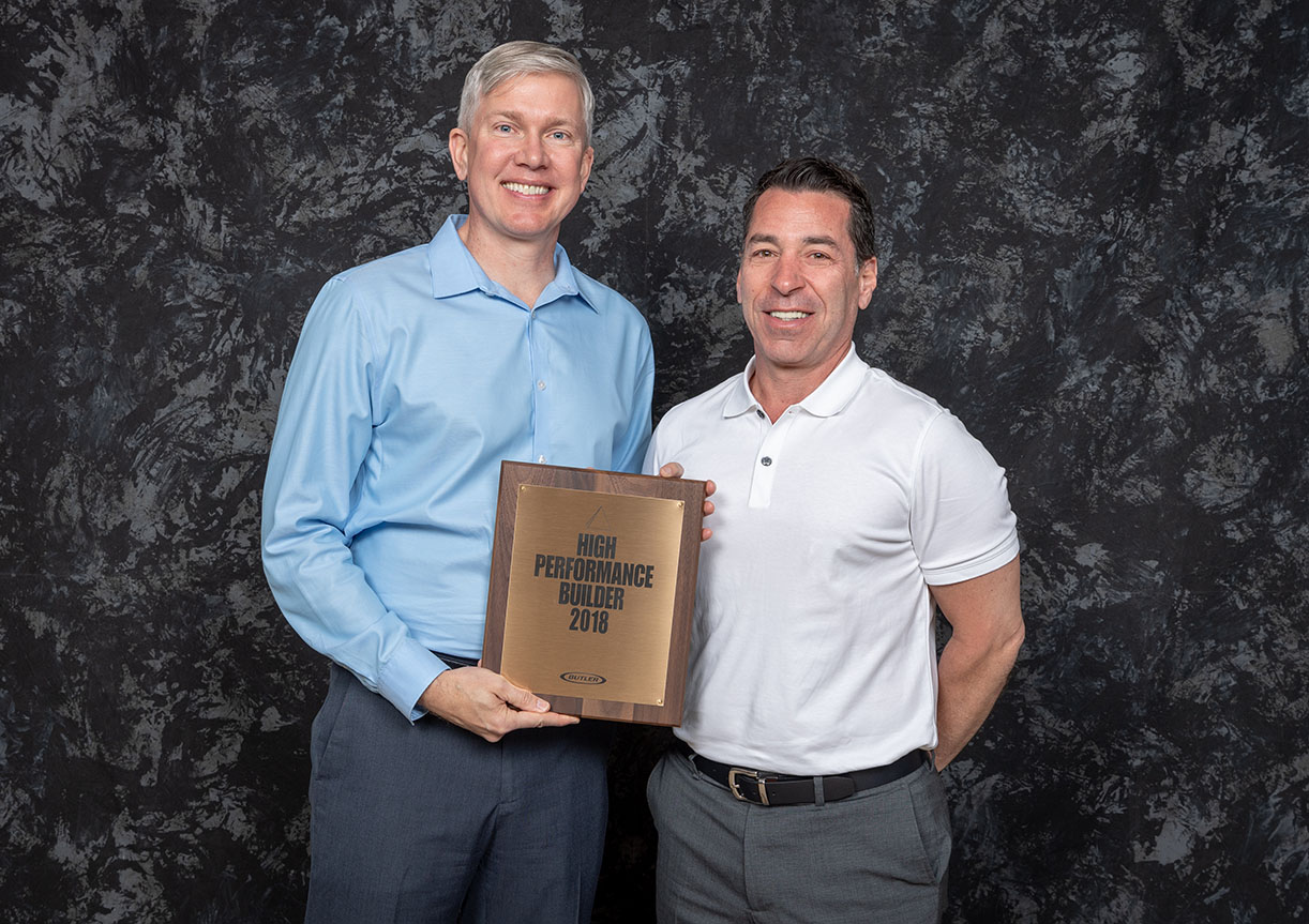 Peter Fazio (Chapple Design-Build President) receiving High Performance Builder award from Greg  Pasley (President Butler Manufacturing).